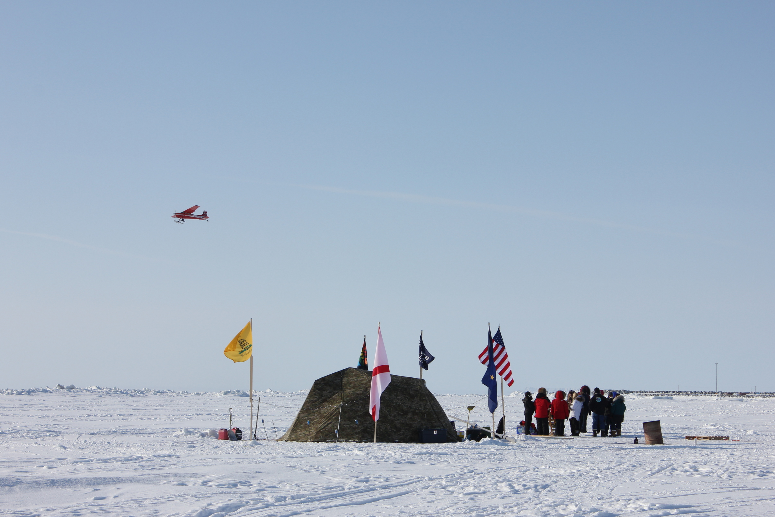 Fest-goers congregated near an under-the-ice mining tent.