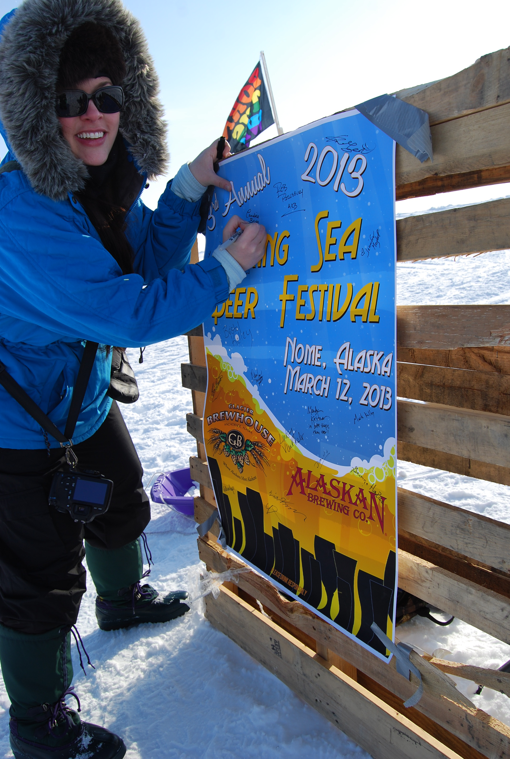 Autographing the brewfest banner.