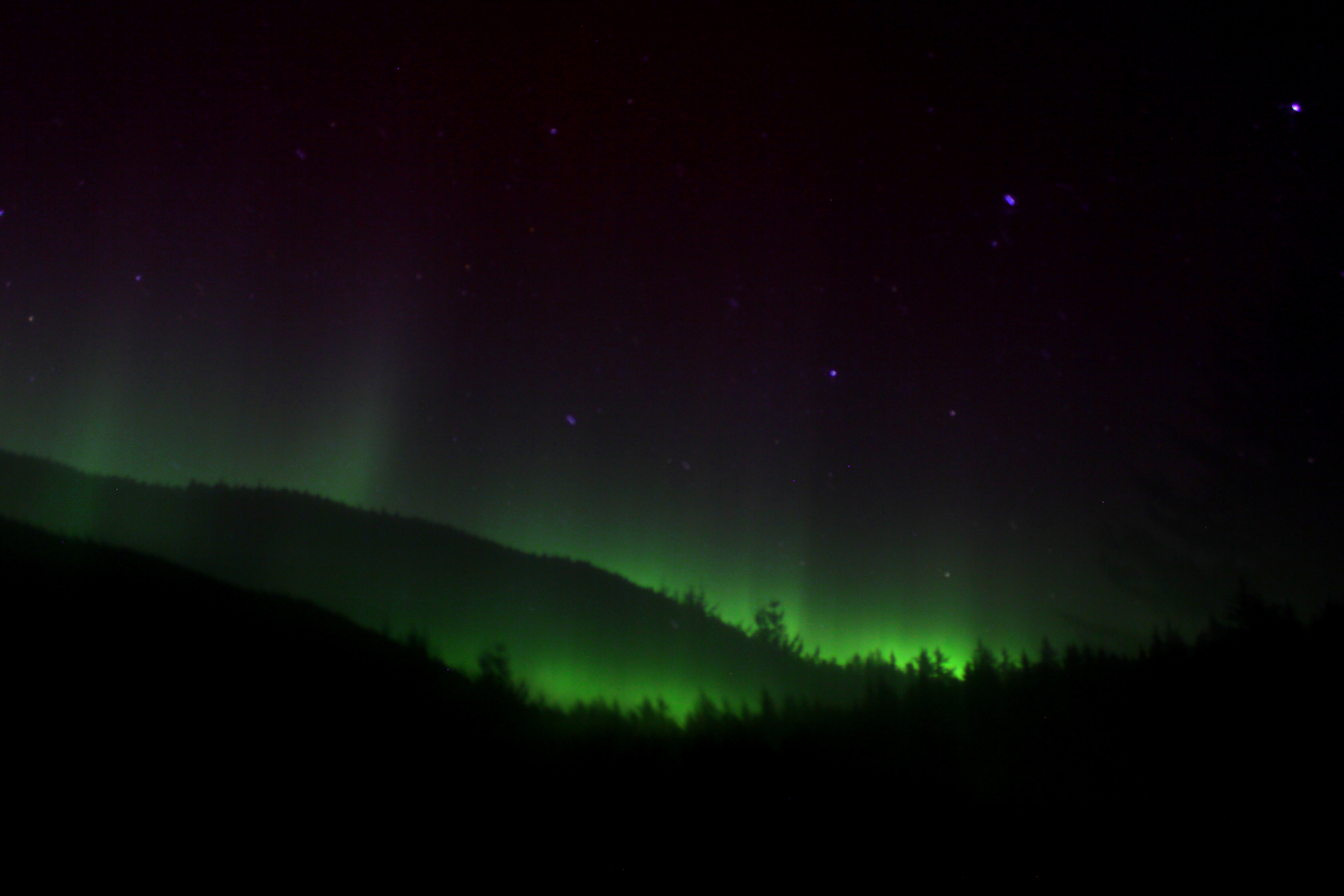 I accidentally bumped my tripod (a big no-no in aurora photography) - and the photo turned out looking like there were two rolling hills in the frame, each with the aurora floating above. Not a bad mistake if you ask me!