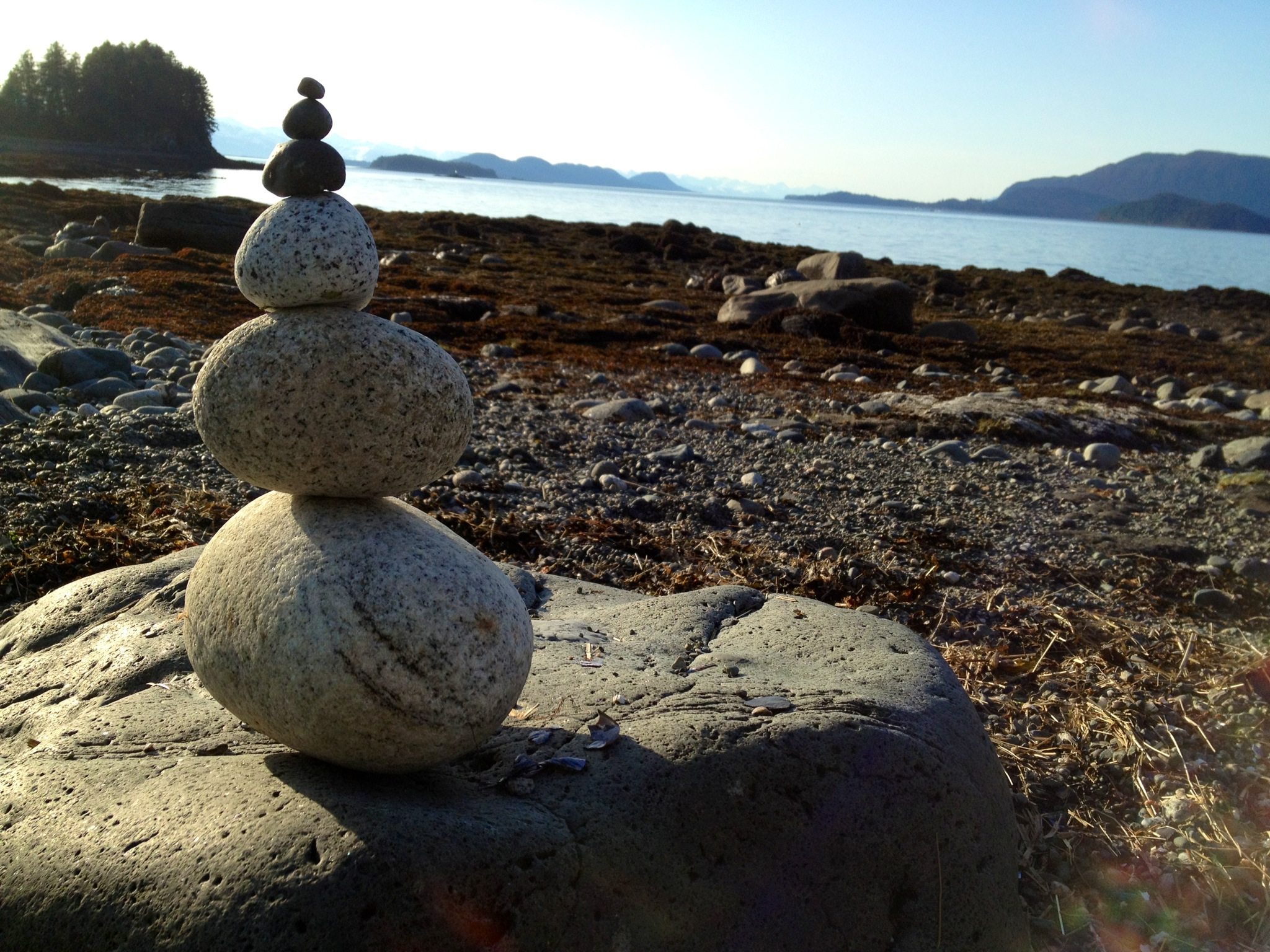 The sun compelled me to construct a small cairn on the beach on Douglas Island.
