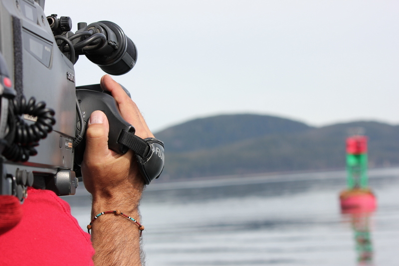 """The cameraman from Seattle's """"Evening Magazine"""" films the occupied buoy."""