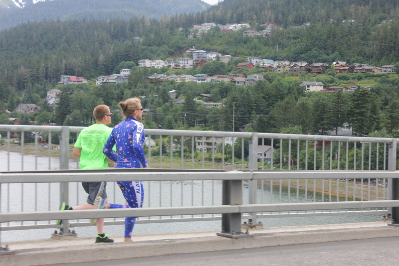 To get to the parade on Douglas Island, one must first drive across the Juneau-Douglas bridge.  OR you can run across it, like these fellas.