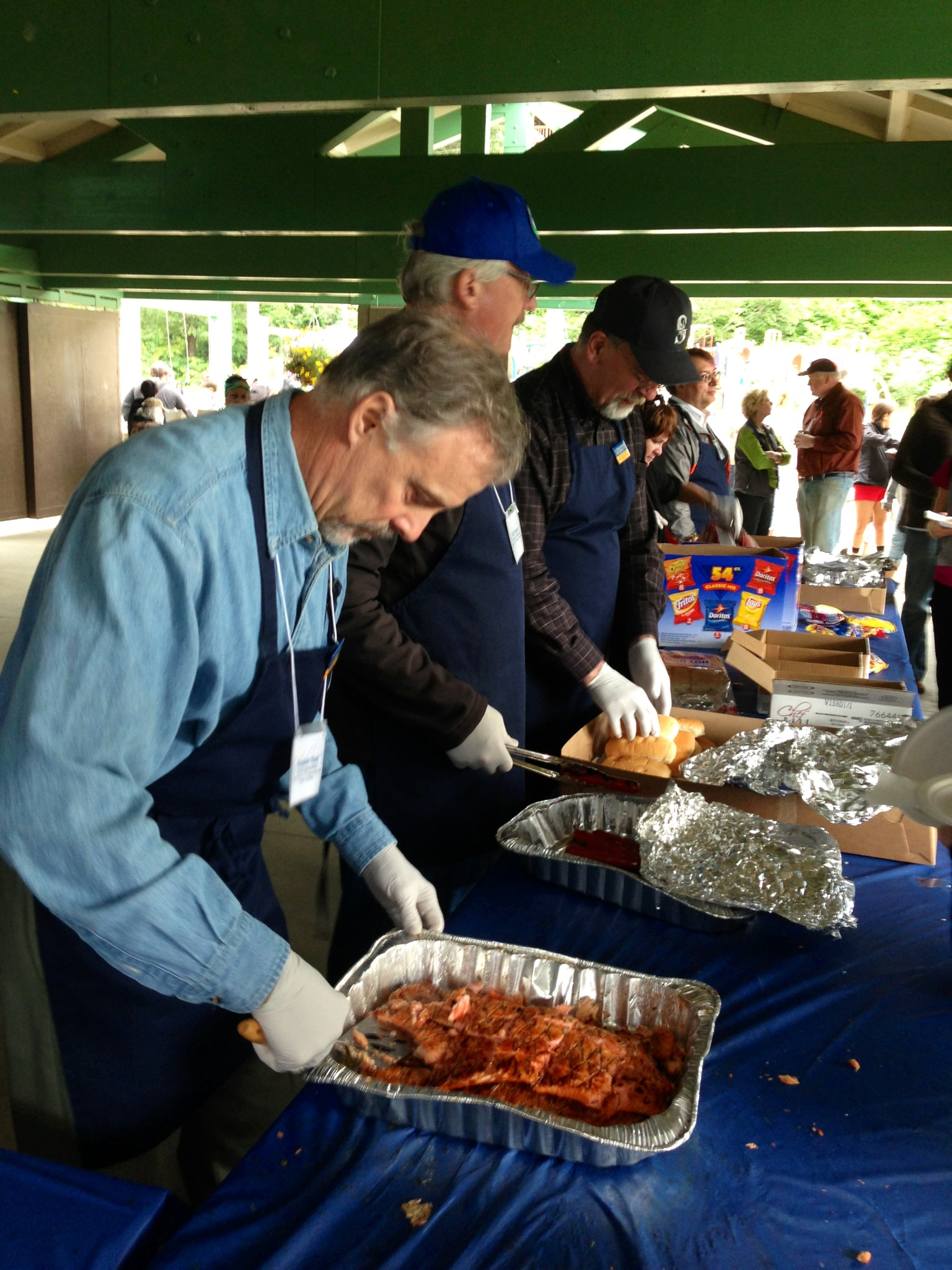 Members of the Governor's Cabinet were on hand to serve the public scrumptious Alaska WILD salmon.
