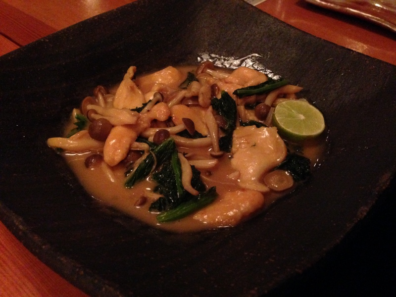 From  Sushi Kappo Tamura : local geoduck tender with mustard greens and shemeji mushrooms sauteed in a sake soy butter sauce.