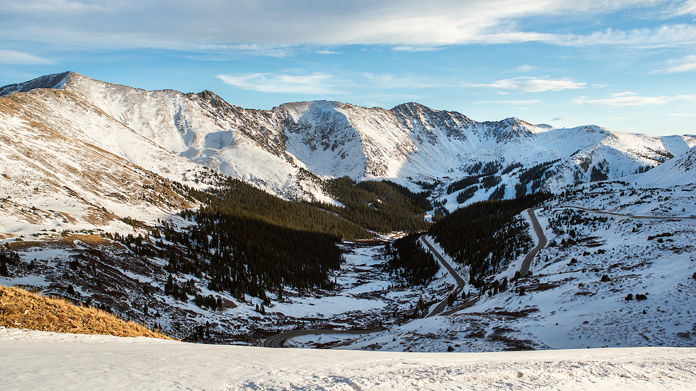 The view south from Loveland Pass toward Arapahoe Basin. U.S. Hwy 6 is visible on the right side of the image. This photo was taken in early fall as snow was beginning to accumulate.