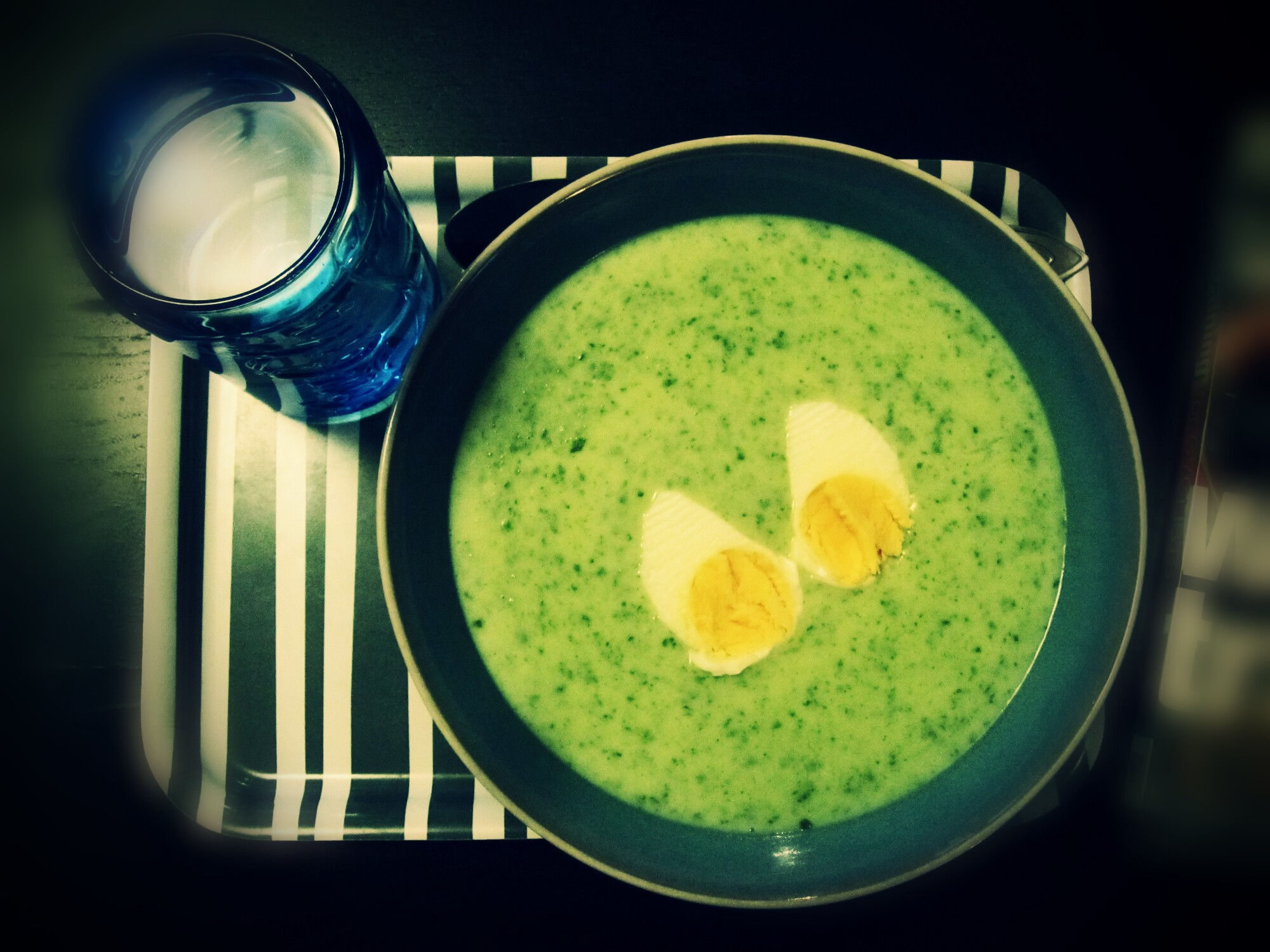 Yummy warm spinach soup with eggs