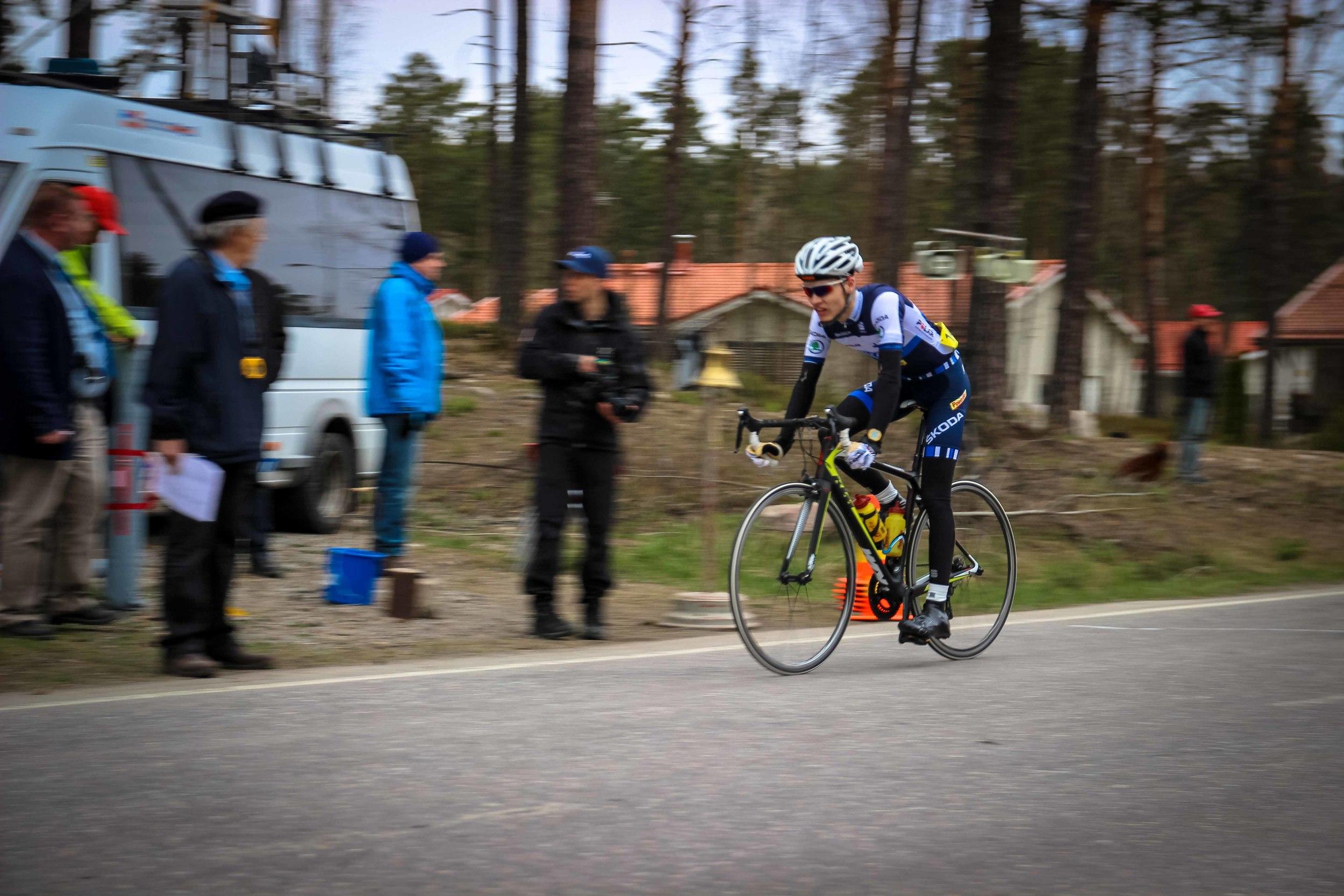 Joel Bergman crossing the finish line just seconds later