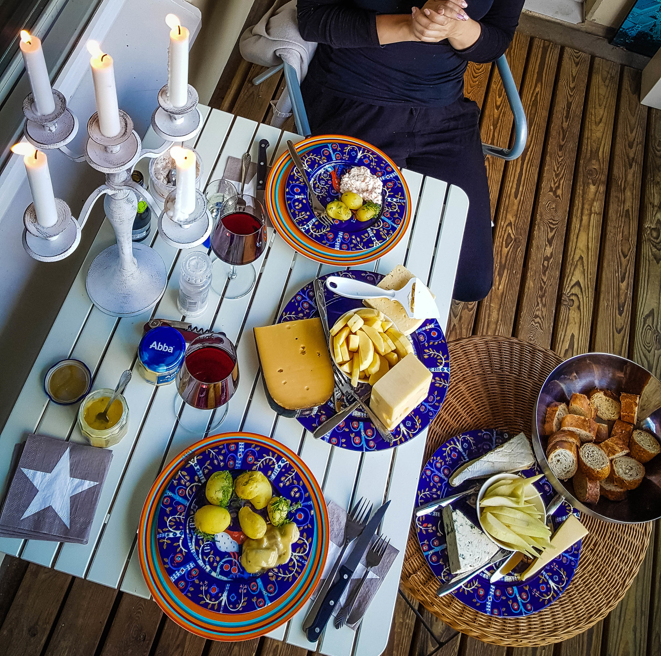 Enjoying food and wine on the balcony