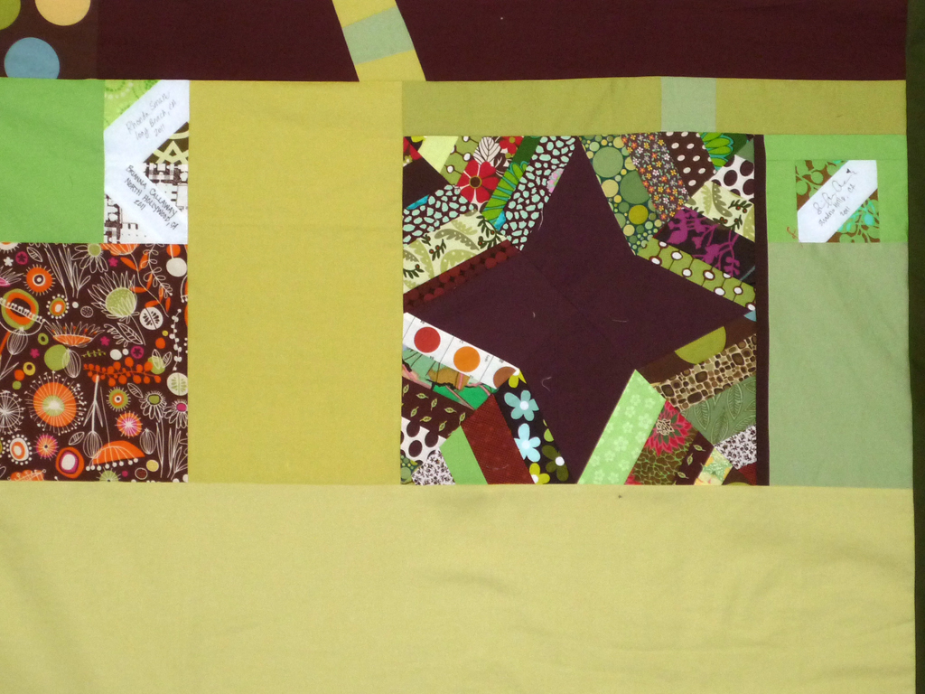 A detail showing one of the odd-sized blocks and a few of the signature blocks.