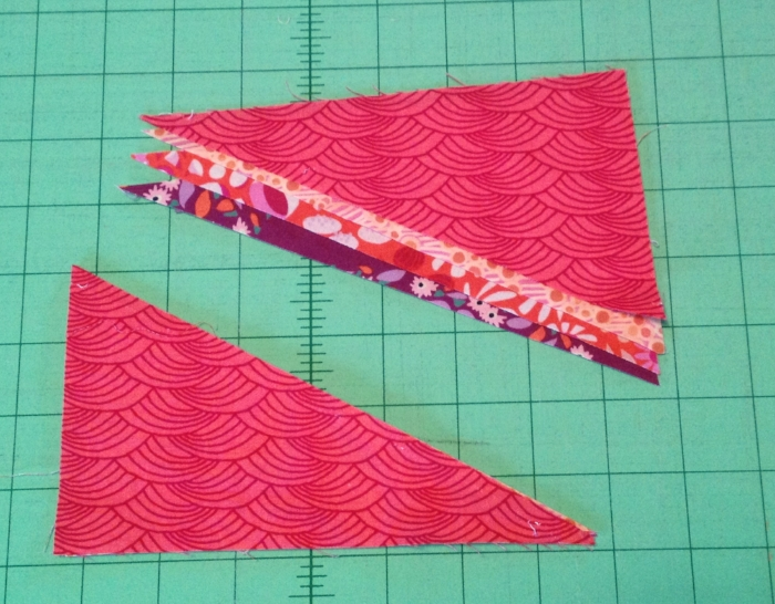 I've only shown the cutting on one of my two stacks... cutting diagonally from upper left to lower right corners.