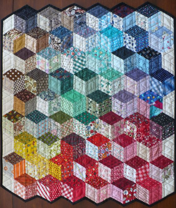 The Little Red Hen, via Pinterest. Here we have what appears to be a true 1-patch tumbling block charm quilt!