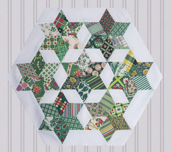Seven Sisters block by Q is for Quilter. Click for source.