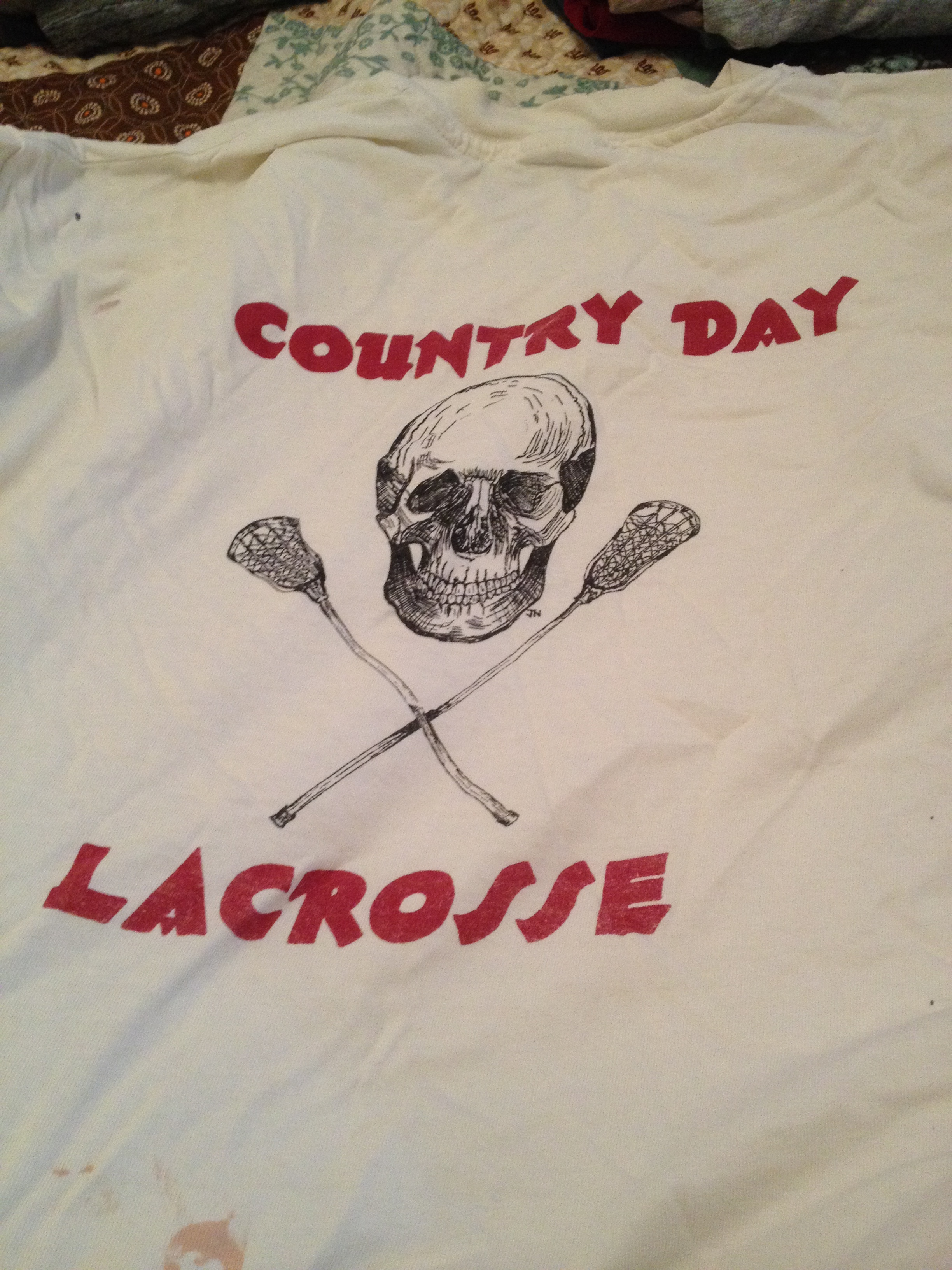 In my spring cleaning, wardrobe edition I cannot bring myself to get rid of this OLD t-shirt for the boys' HS lacrosse team (I let go of our girls' team shirt many, many years ago, as is appropriate).
