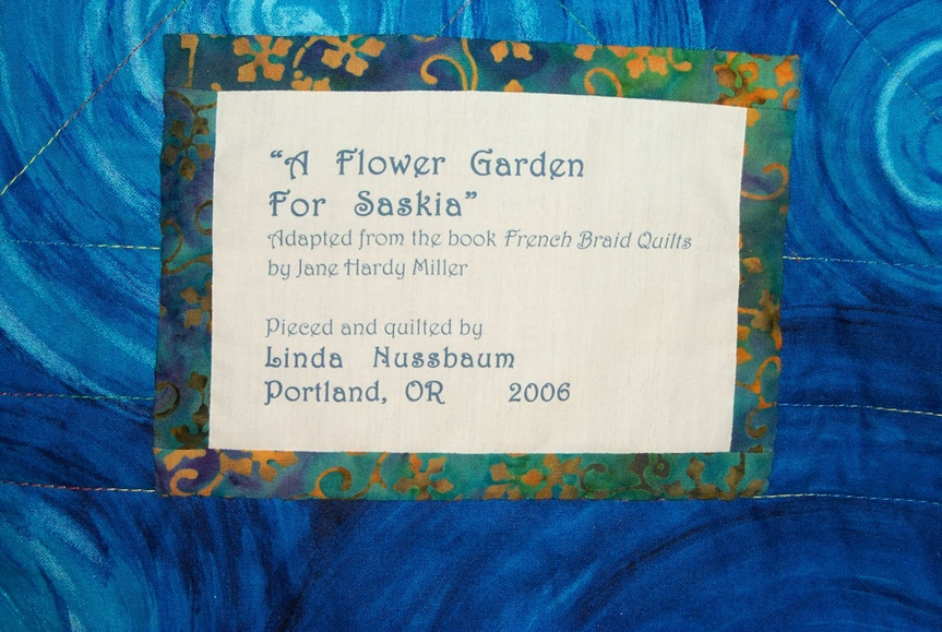 The printed label applied to the back of the quilt.