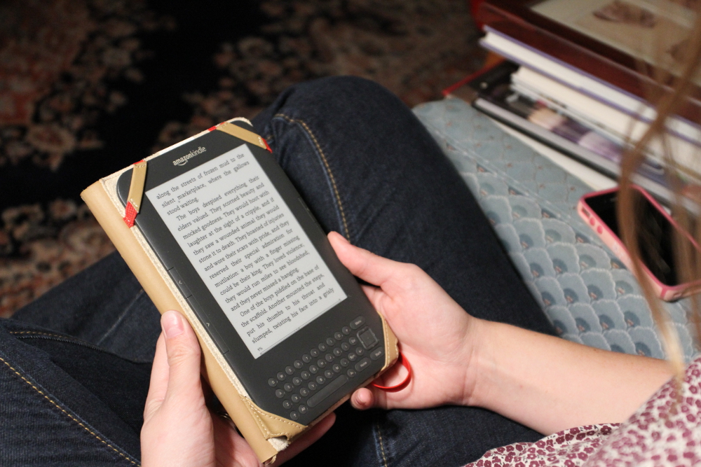 The Kindle and iPhone - Two devices that make the world a better place   Credit - Trey Comstock (Tech's Last Call)