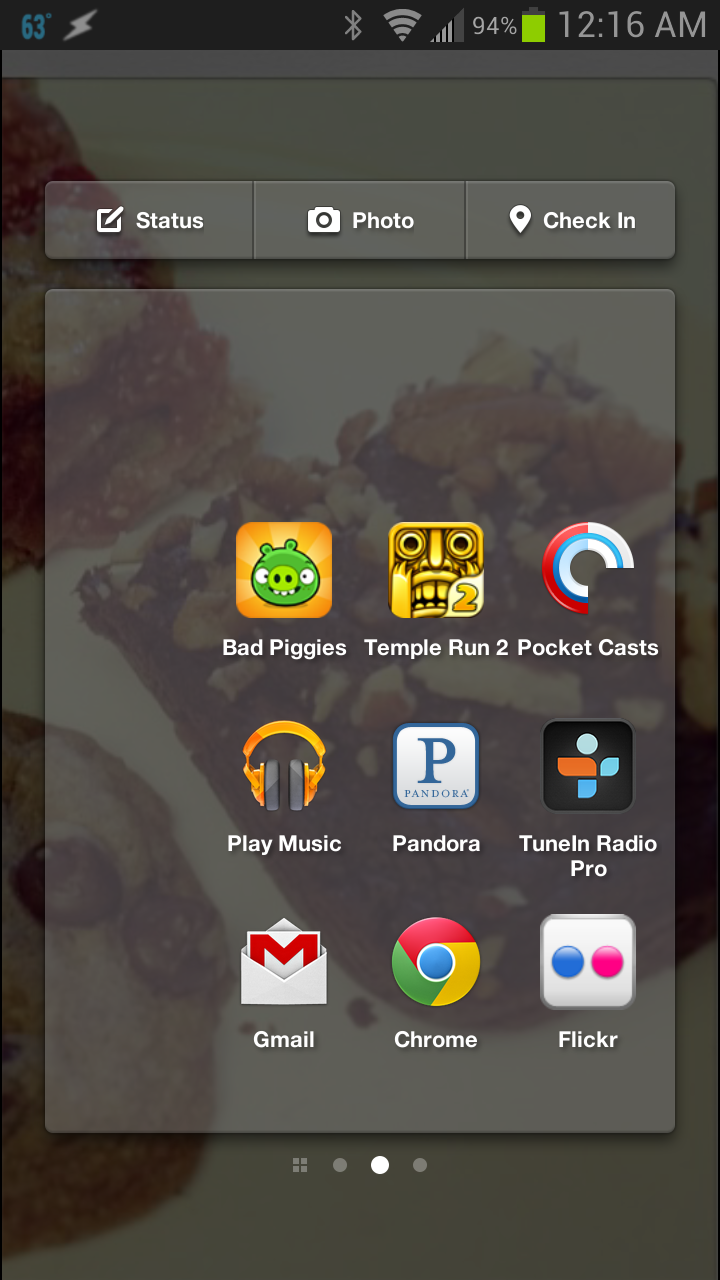Facebook Home's App launcher. Notice the Facebook Check-in, Photo, and Status tabs at the top ( Credit: TLCP/Jimmy Principe)