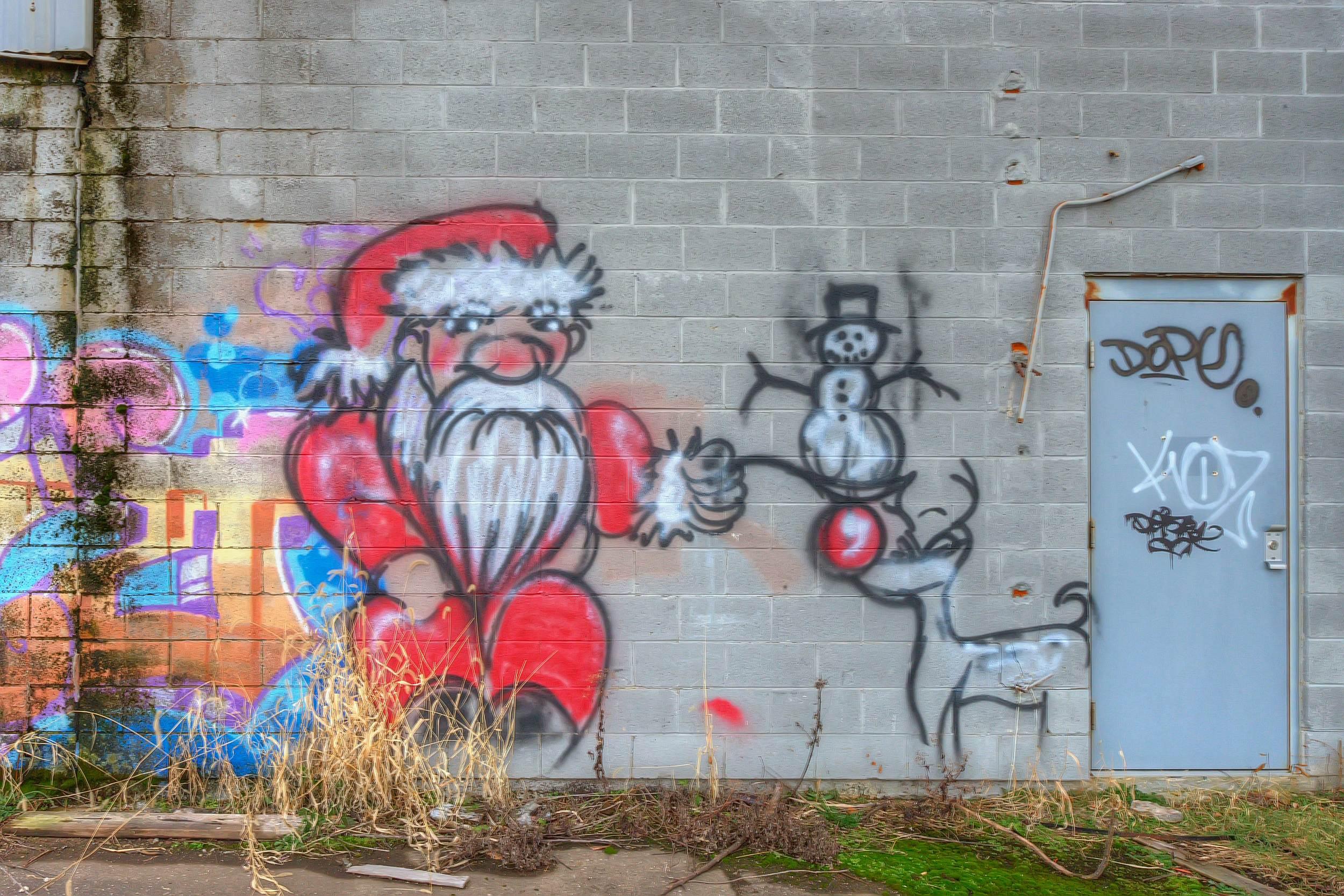 Santa, Reindeer, & Snowman Graffiti on abandoned factory building