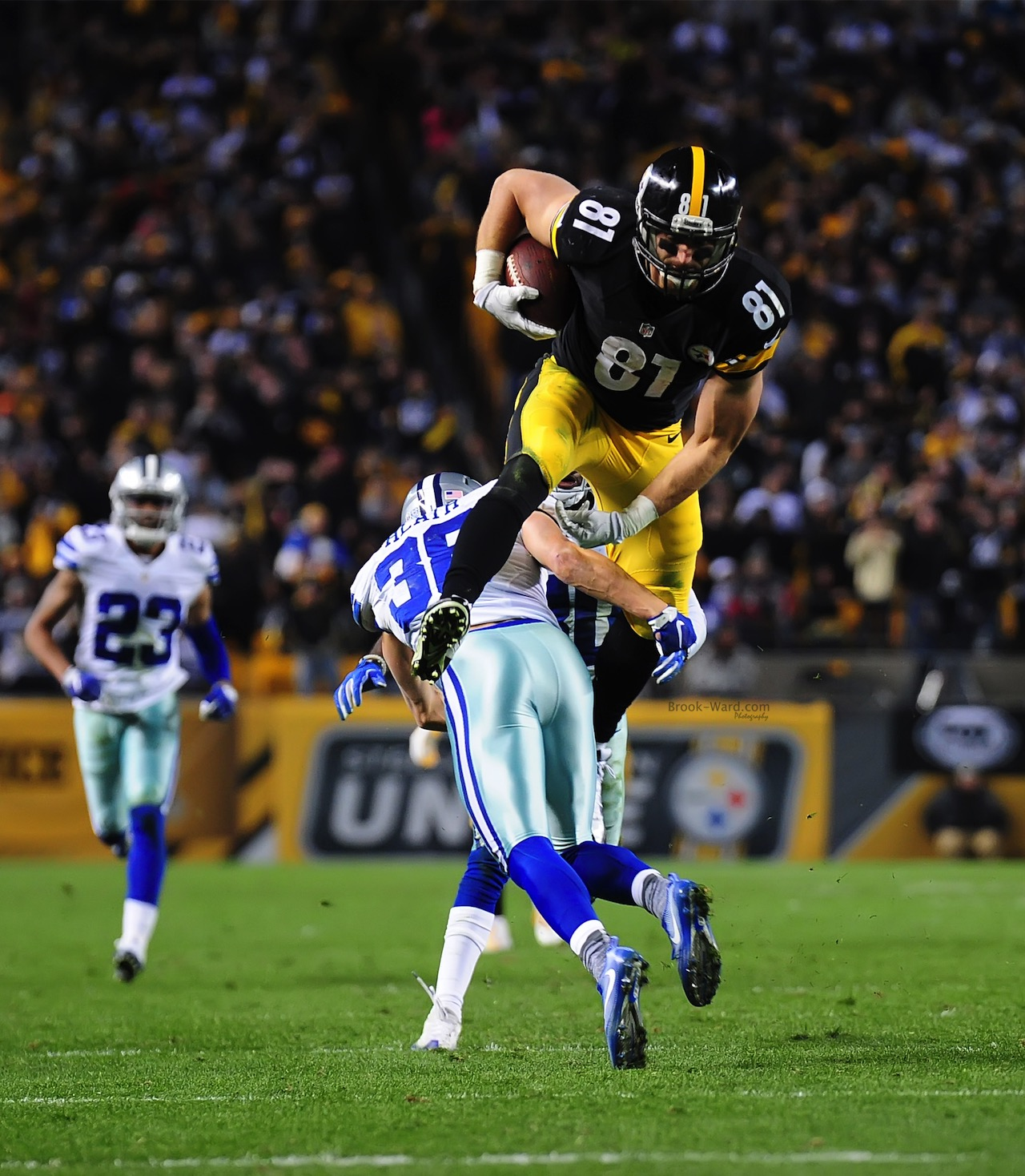 Jesse James leaping over a Dallas defender