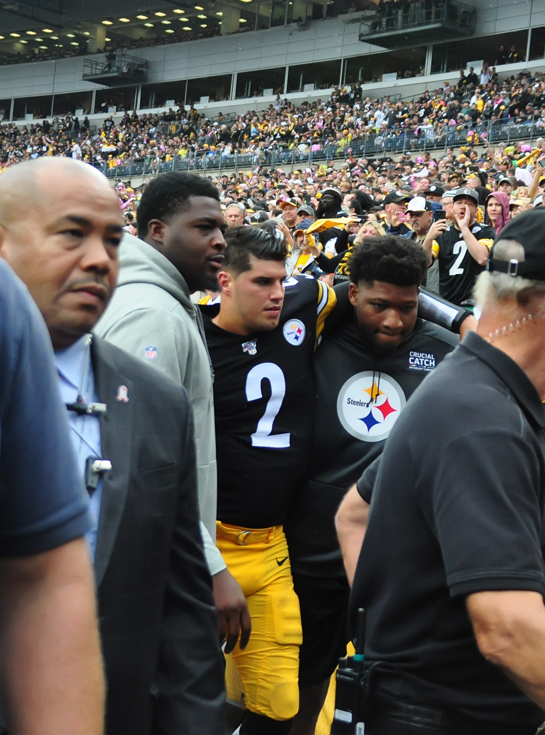 Team members helping him to the tunnel