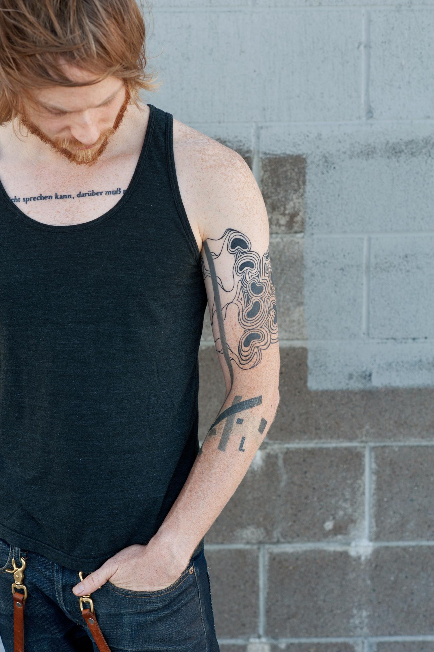 Black + Blue Tattoo
