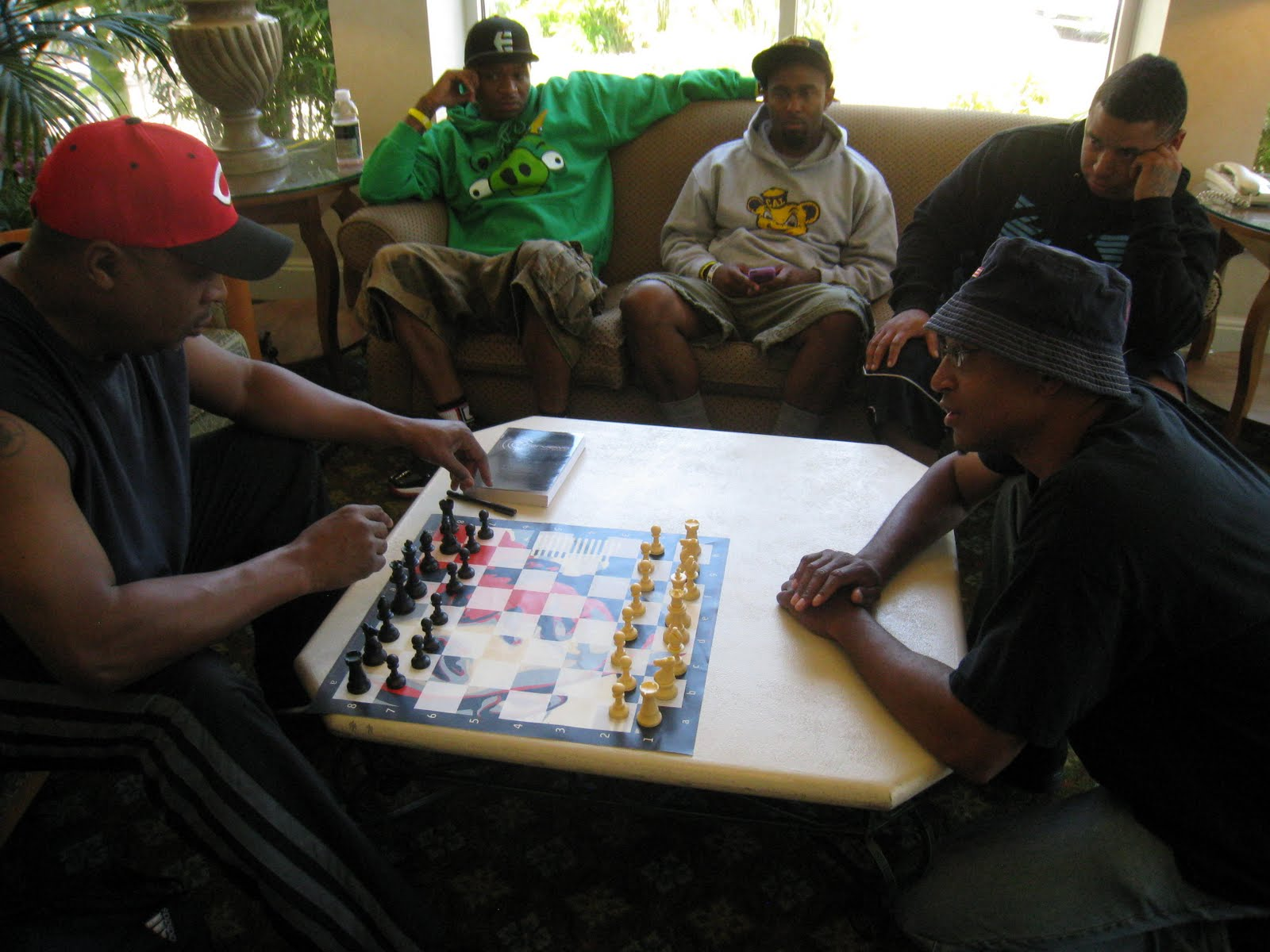 Chuck D of Public Enemy and Adisa play a game on a Barack Obama board...