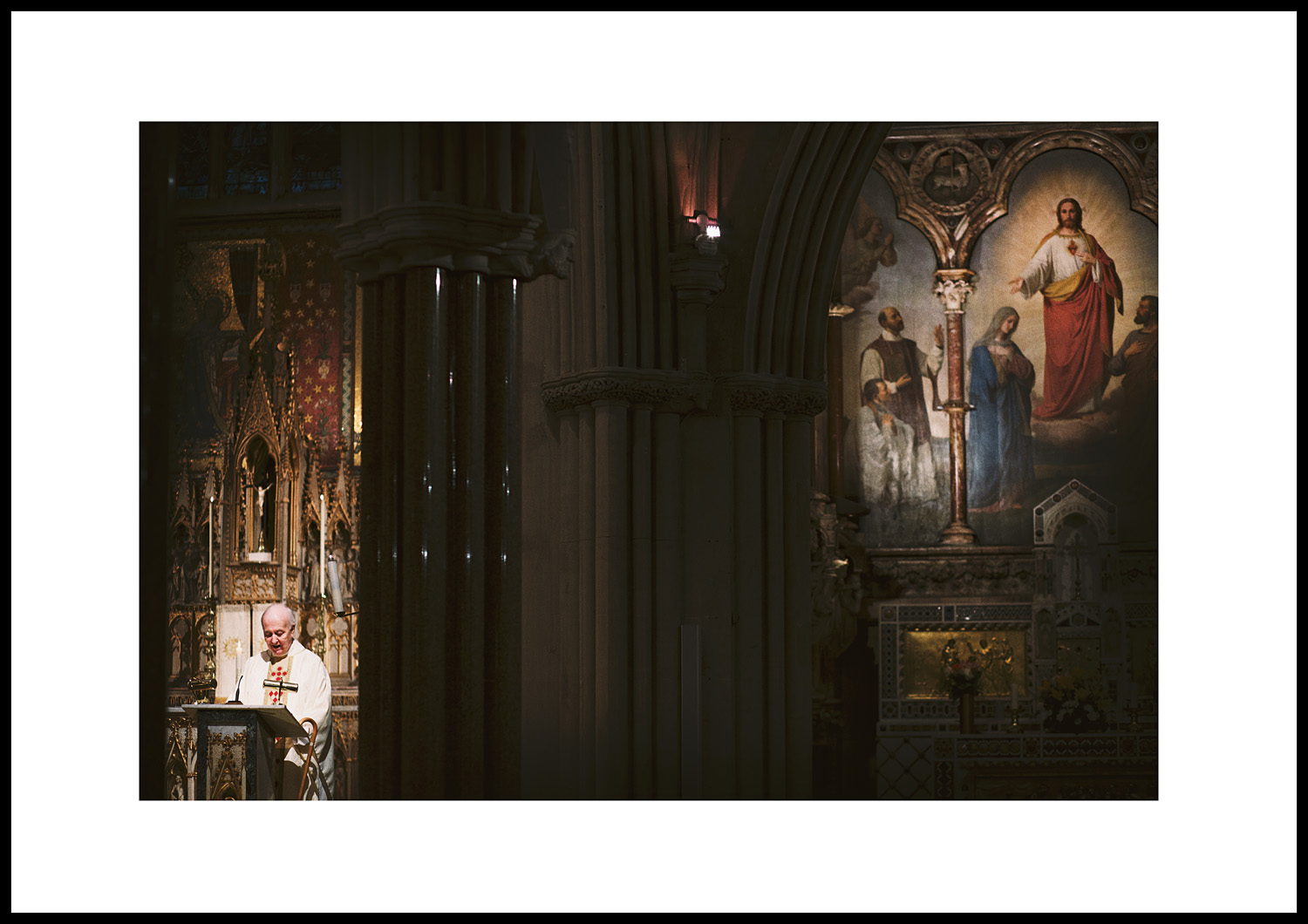 The Priest addresses the congregation ahead of the bride's arrival... (85mm lens, 60th/F4, 2500asa)