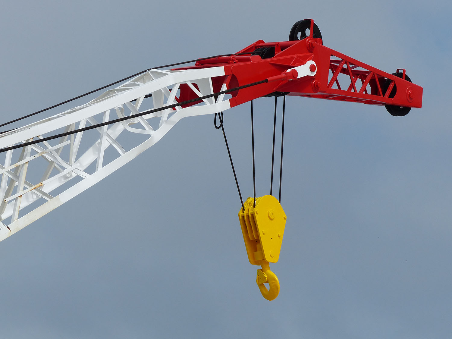 This rig has two cranes to move supplies and people on and off the rig and to move the pipe