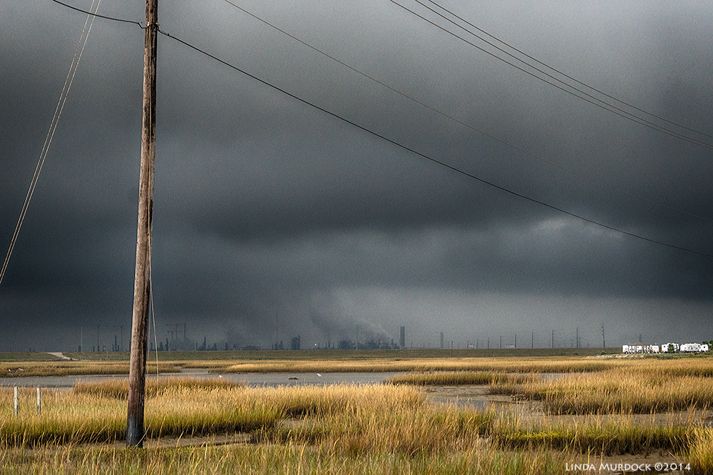 View over the marsh toward the refineries at Freeport    Sony A77 II with 70-400mm G21/800 sec. f/5.6 ISO 1000