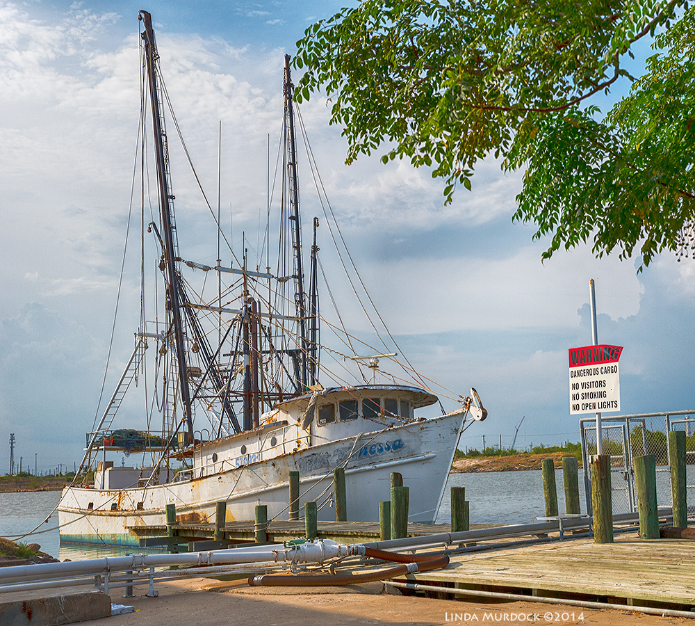 Old shrimp boat moored at Freeport     Sony A77 II with DT 16-50mm 1/1600 sec. f/6.3 ISO 400