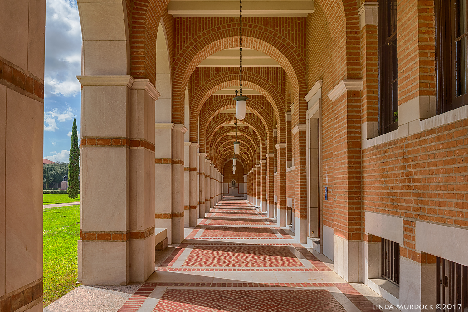 Arched hallway at Rice University Nikon D810 with Tamron 15-30 f/2.8 ~ ISO 400 f/8 at 30mm HDR; tripod