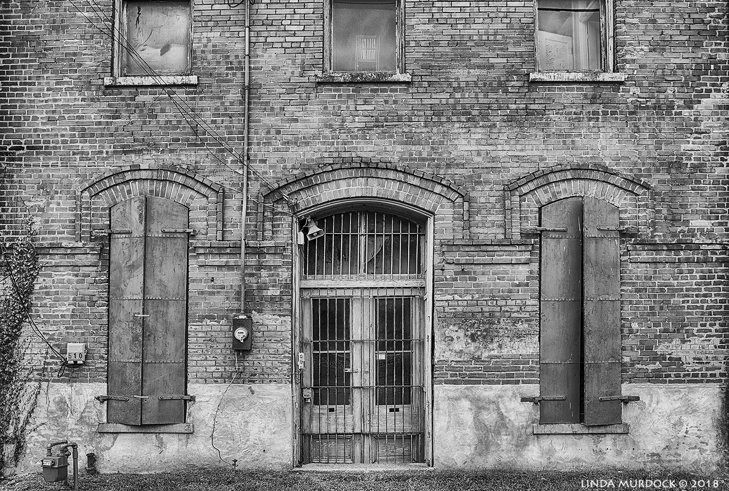 Wooden shutters are probably original but the iron bars might have come later?   Nikon D810 with Tamron 15-30 f/2.8 ~ ISO 100 f/8.0 at 30mm HDR; hand-held