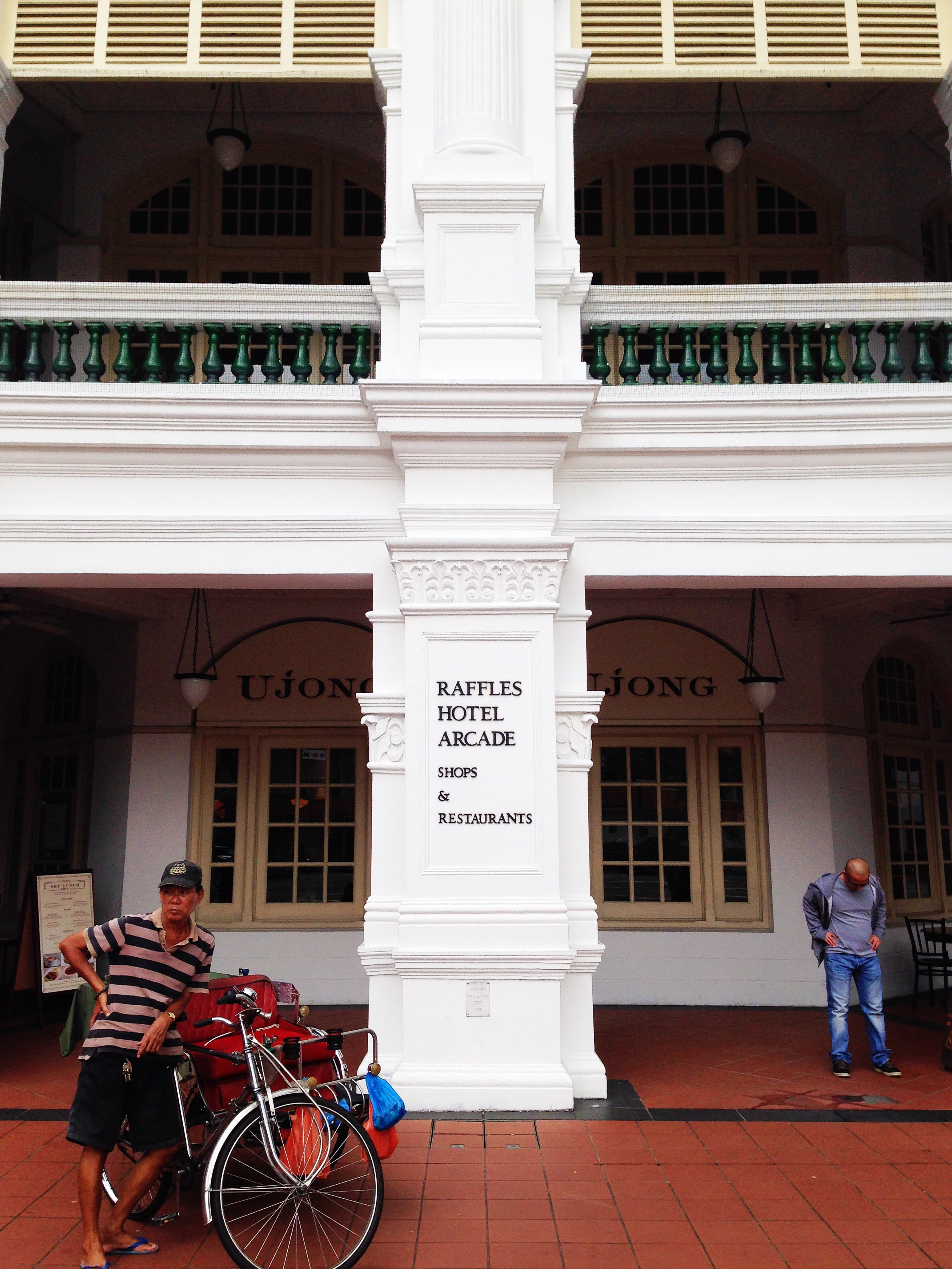 Rickshaw driver on duty in front of the Raffles