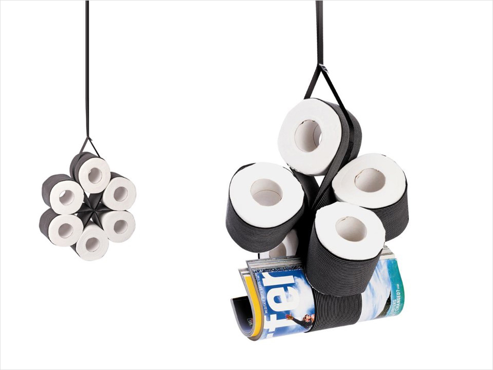A dispenser for toilet paper rolls.    Material: rubber strip  Size: H40 x W8 cm  Client: Monkey Business