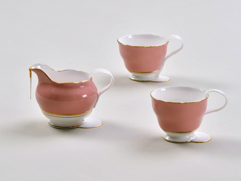 """This collection relates to Zohar's childhood experiences: In the meticulously-kept apartment of the """"Ashkenazi Sisters"""" (who were neighbors of Zohar's aunt), abounding with porcelain and crystal, Zohar used to regularly attend the tea ceremony. Tea was served in gold-rimmed teacups, totally ignoring the Israeli climate outside. On the other hand, a simple set of dishes was used in her childhood home with its sabra culture, which distanced itself from the bourgeoisie.    As a designer, Zohar often connect s  between materials and aesthetic languages, as she does in this work when she connects between dignified porcelain and industrial silicone.    Replacing parts of the porcelain utensils with industrial silicone arise s  aesthetic and functional questions.       Exhibition: The Seventh Biennale for Israeli Ceramics, Imprinting on Clay- Cultural Memory in Contemporary Ceramic Art, Eretz Israel Museum, Tel Aviv."""