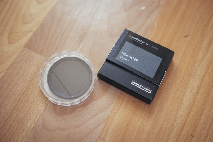 An ND x4 filter for the lens. Quarters the amount of light entering the lens (2 stops)