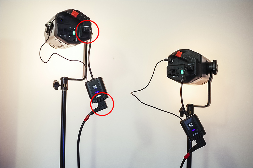 The Godox receivers plugs straight into the flash heads power socket and then you plug the power directly into that. This negates the need for additional batteries.