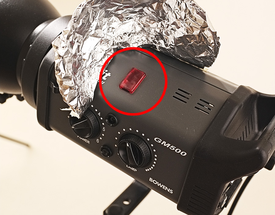 """The little red square circled here is what looks for other flashes firing and triggers itself to flash. (Ignore the tinfoil here, that was used to """"boost"""" the light capturing abilities of the head. It works but it's hardly very professional looking.)"""