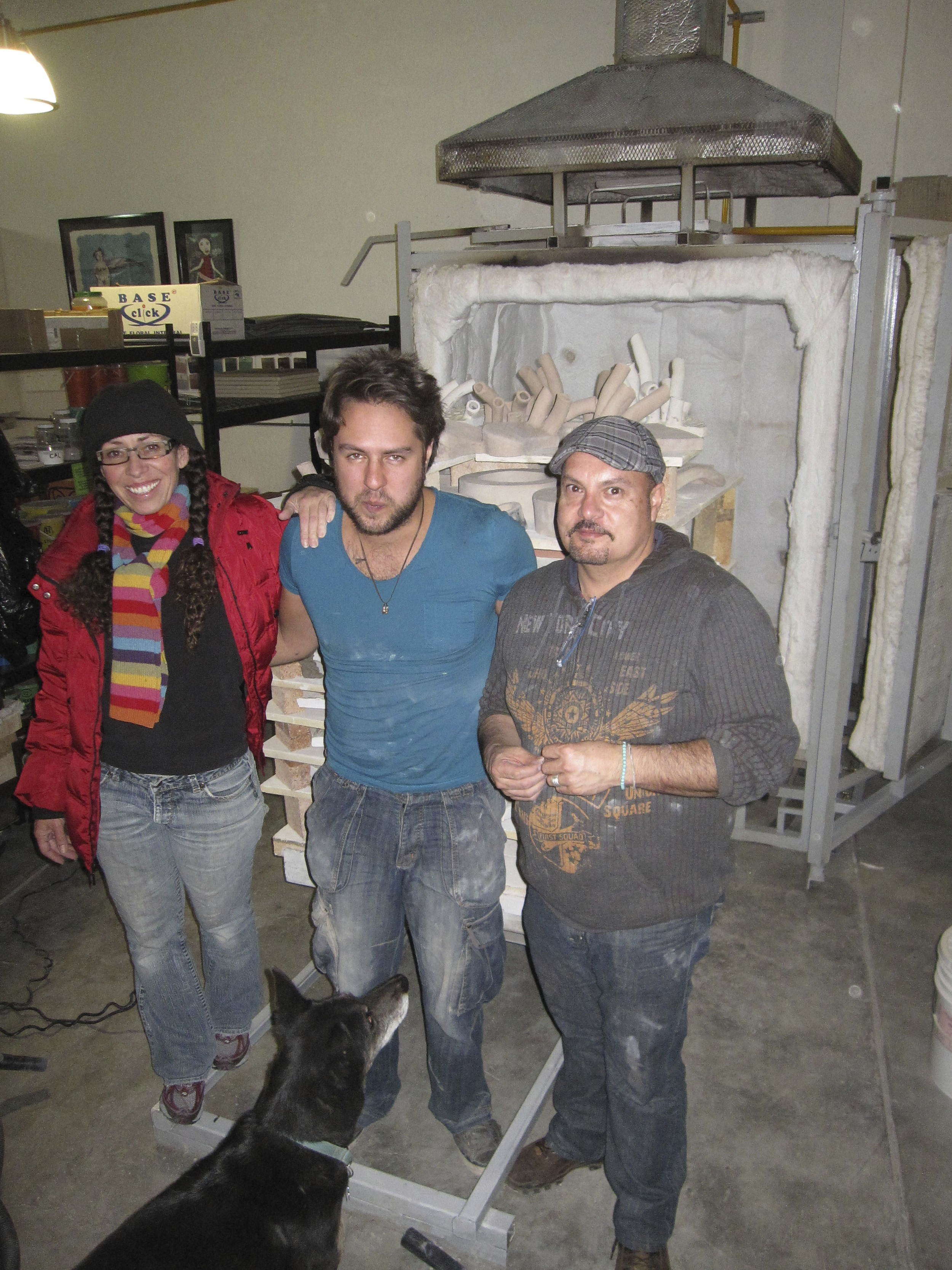 Adria, Federico and Marco Vargas loading the kiln