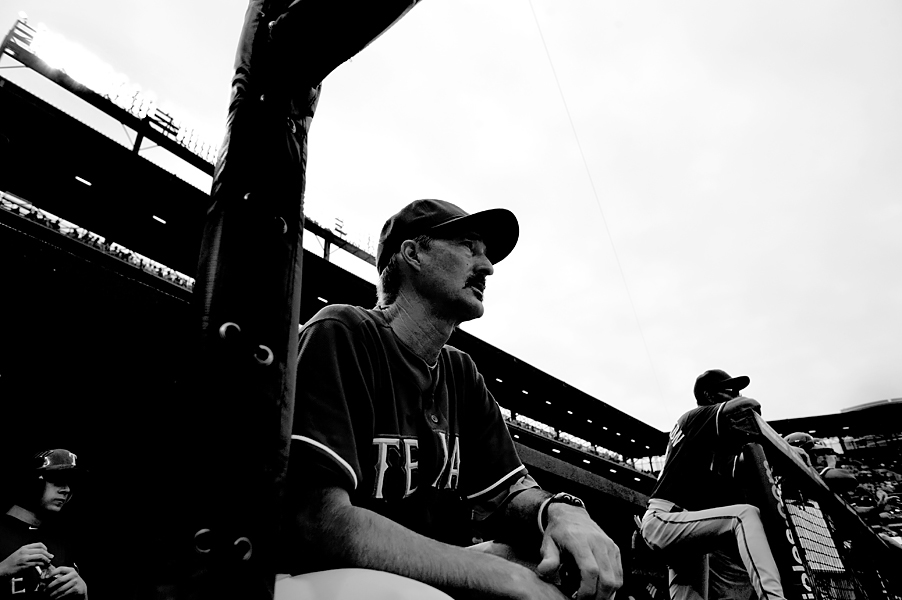 Texas Ranger's pitching coach Mike Maddux looks out onto the field during a game against the Baltimore Orioles.