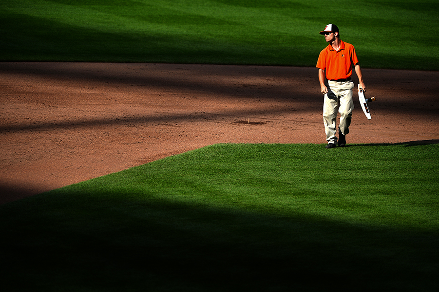 Baltimore Oriole's grounds crew member replaces second base during a home game.