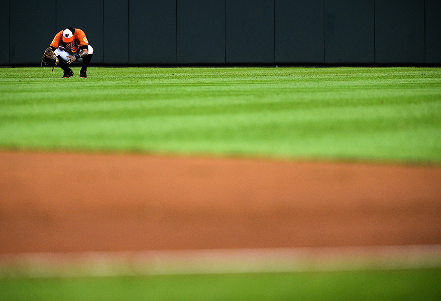Baltimore Orioles center fielder Adam Jones reacts after missing a big catch at a home game in Baltimore, MD.