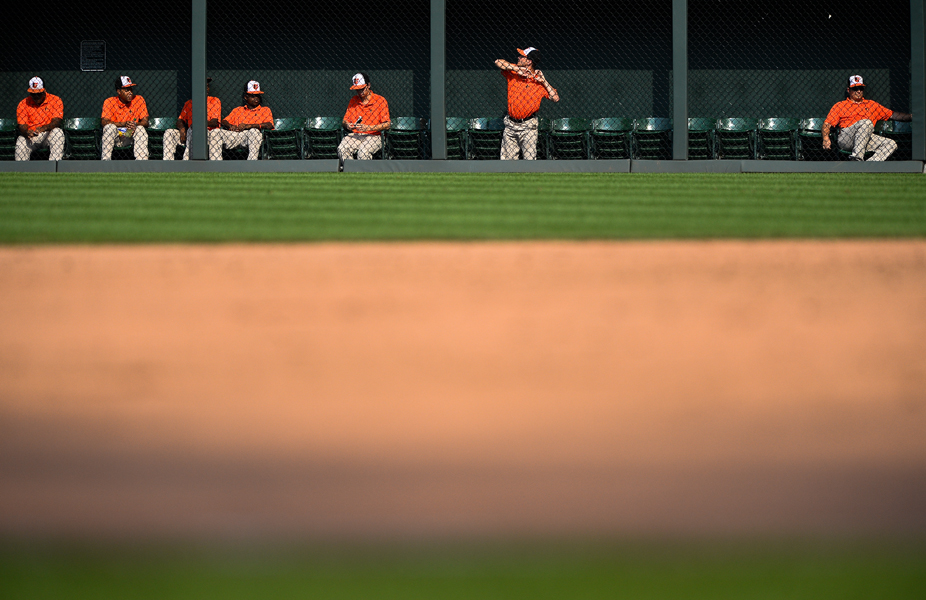 The Orioles grounds crew waits during a home game against the White Sox on Sept. 8, 2013.