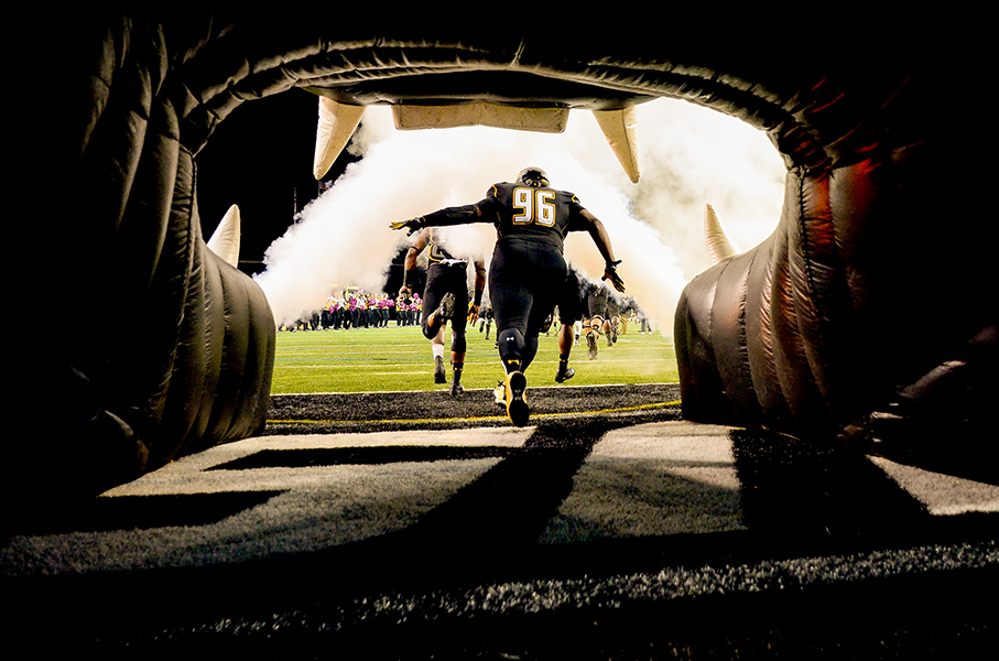 Towson University defensive tackle Arnold Farmer runs onto the field during a home game against Villanova on Oct. 12, 2013 in Baltimore, Md.