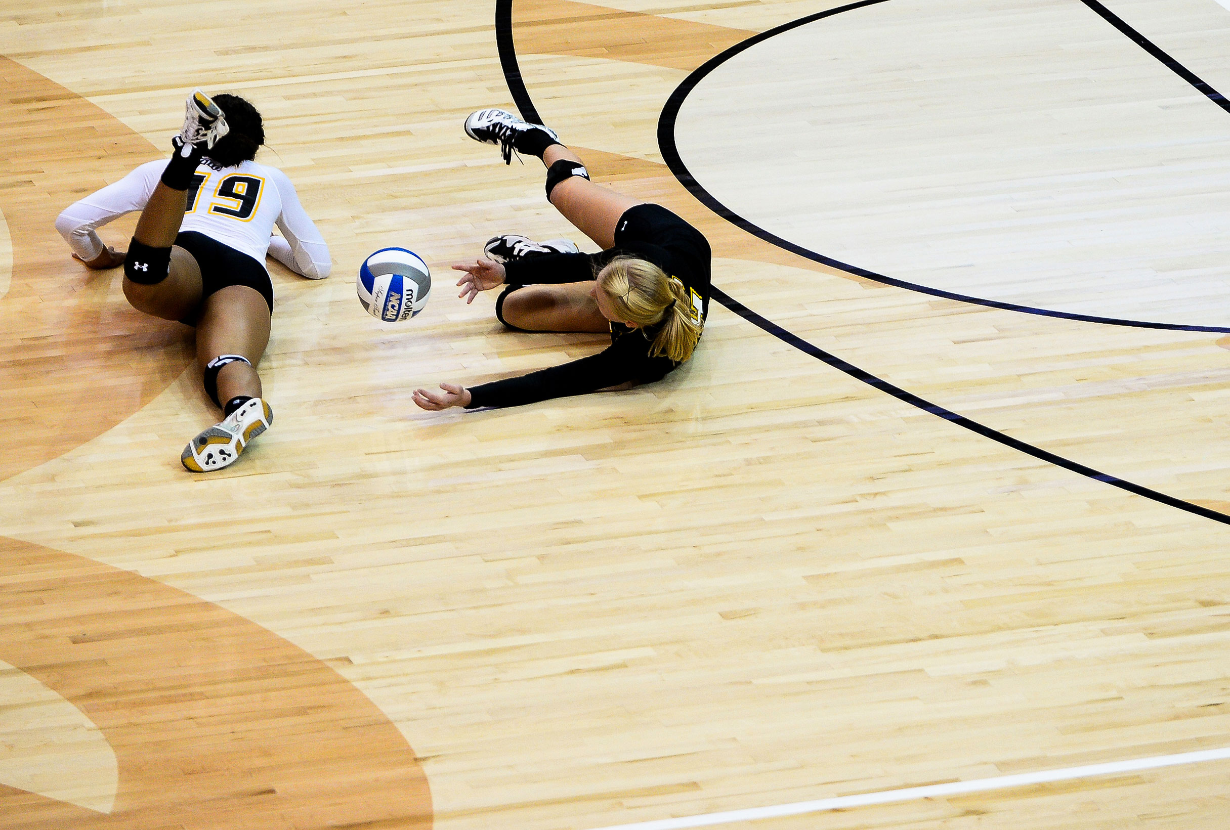 Towson University volleyball players attempt to dive for a ball during  their home opener against Coppin State University in Baltimore, MD on Sept. 3, 2013.