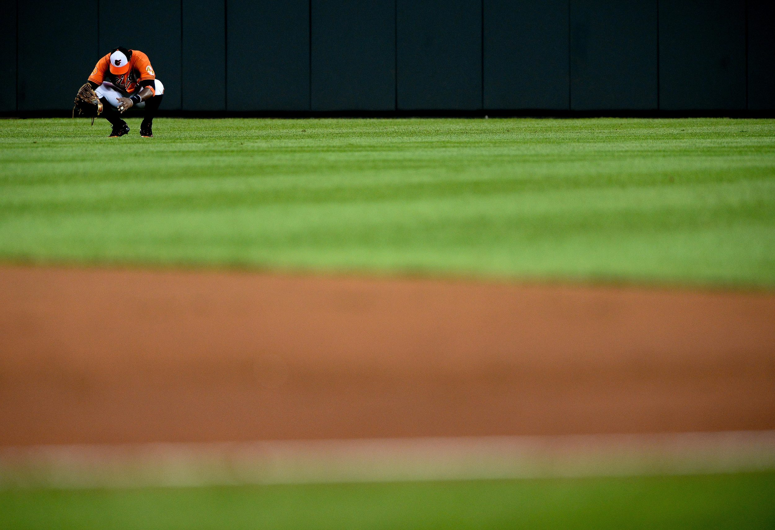 Baltimore Orioles center fielder Adam Jones reacts after missing a catch on July 27, 2013 in Baltimore, Md.