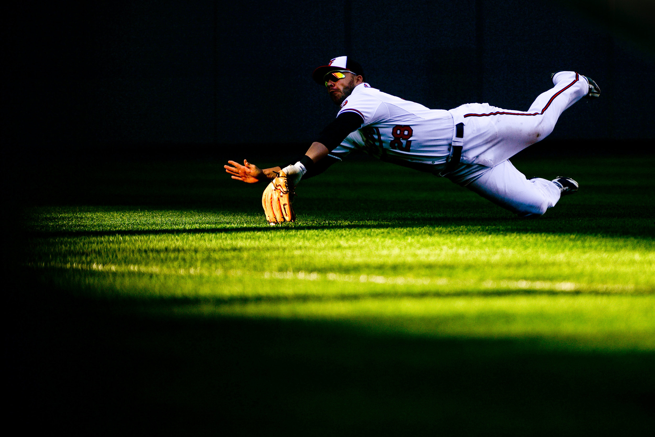 Baltimore Orioles left fielder Steve Pearce attempts to dive for a ball  during their last home game of the 2013 season on Sept. 29, 2013 in  Baltimore, Md.