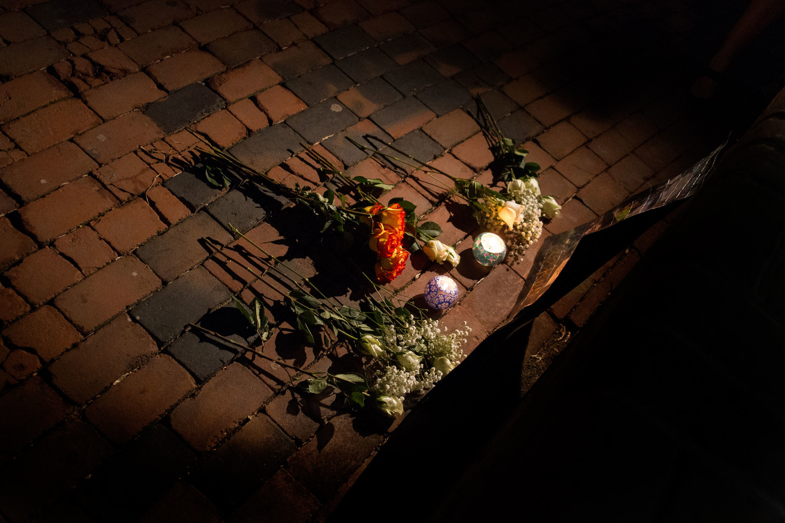 A small memorial is left at the front of a candlelight vigil for two Towson University students who died on March 31, 2012 in separate incidents.