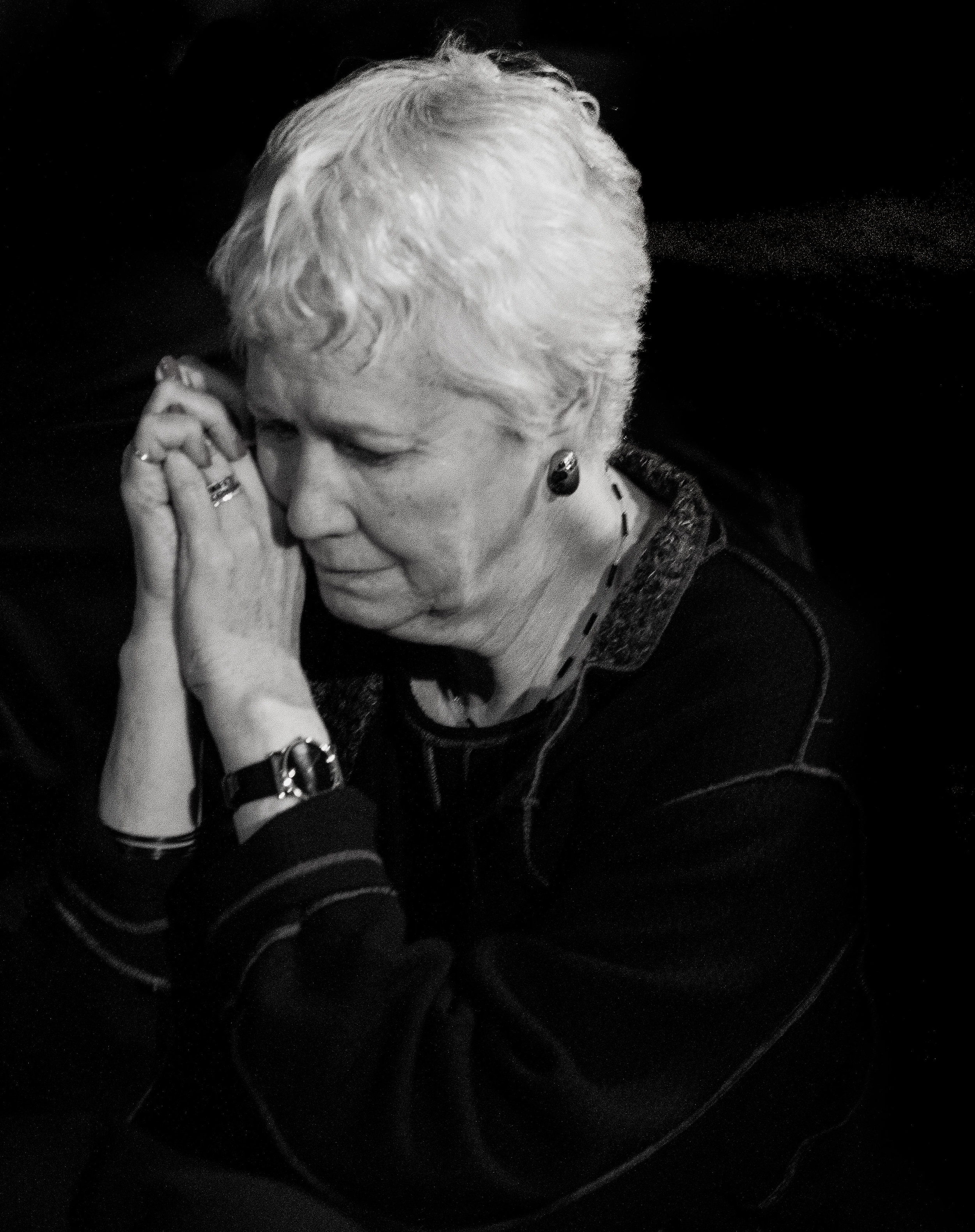 Maravene Loeschke, president of Towson University, takes a moment to herself after delivering a speech at the candlelight vigil for Towson University students  Ryan Bailey and Timothy Coyer, who died Saturday, March 31, 2012 in  separate incidents.