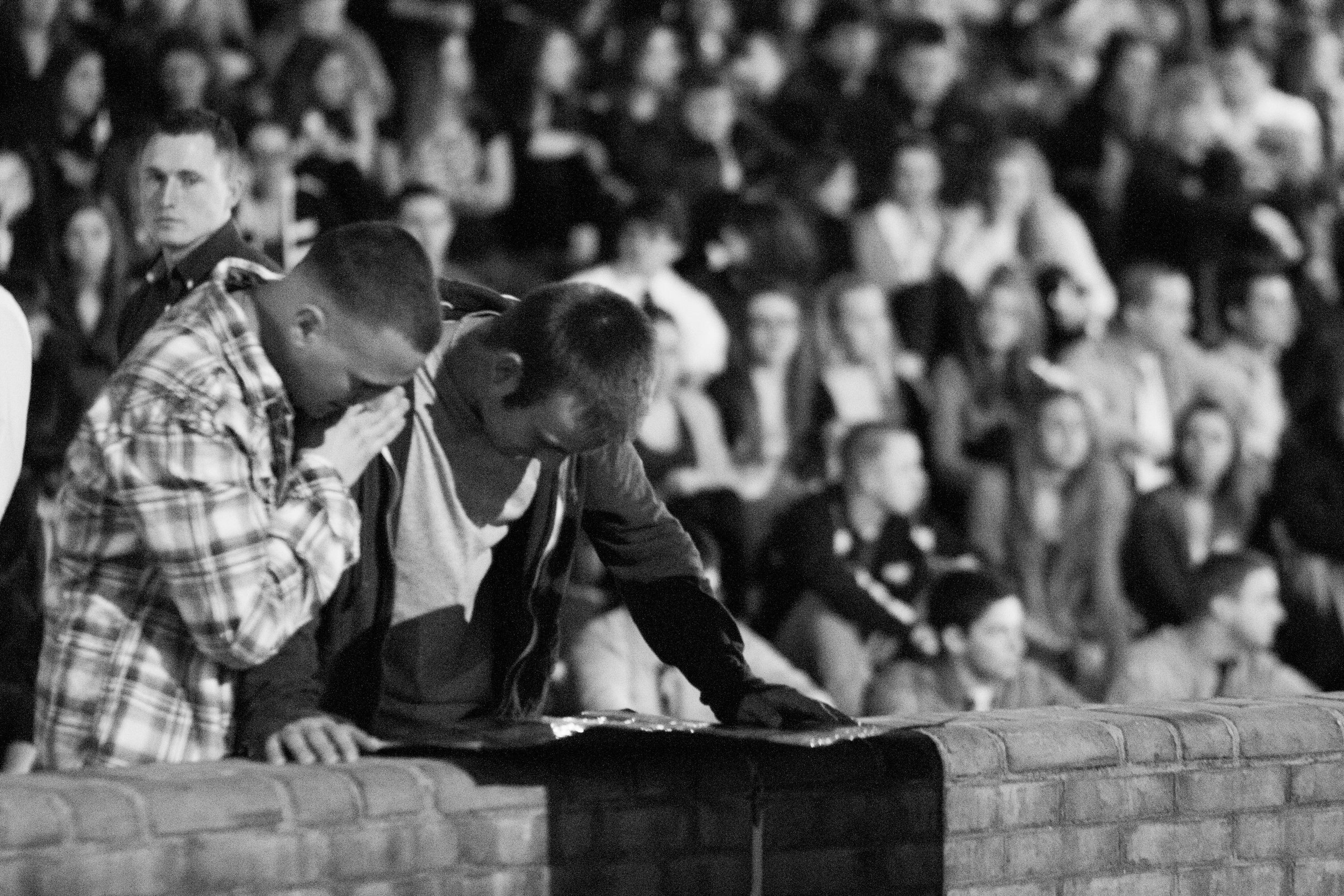 Friends and family of Timothy Coyer, a Towson University student who  died on March 31, 2012, comfort each other during a candlelight vigil  held on campus in Baltimore, Md.
