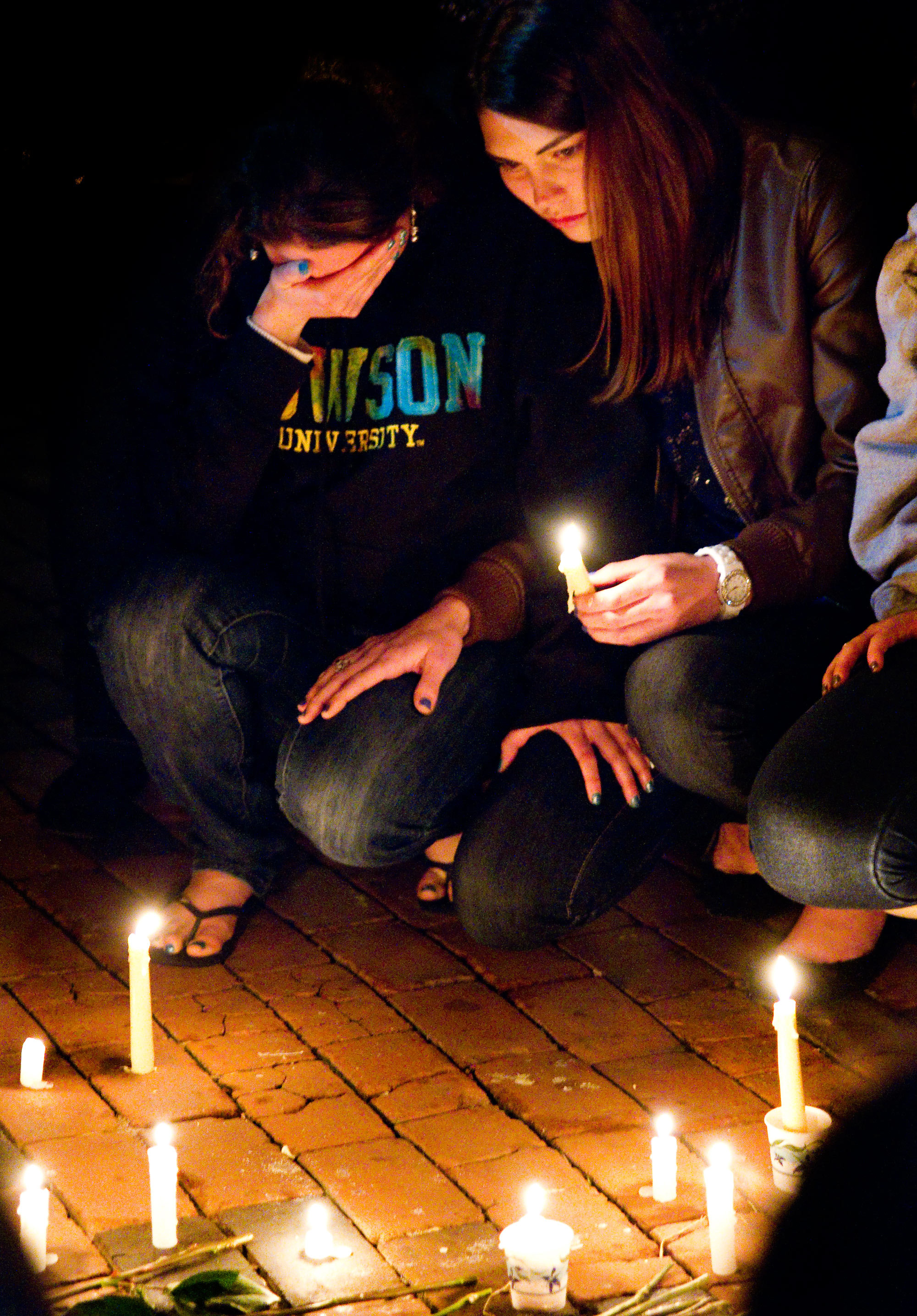 Towson University students gather together to mourn the death of two  fraternity members who died over the same weekend in two separate  incidents on March 31, 2012 in Baltimore, Md.